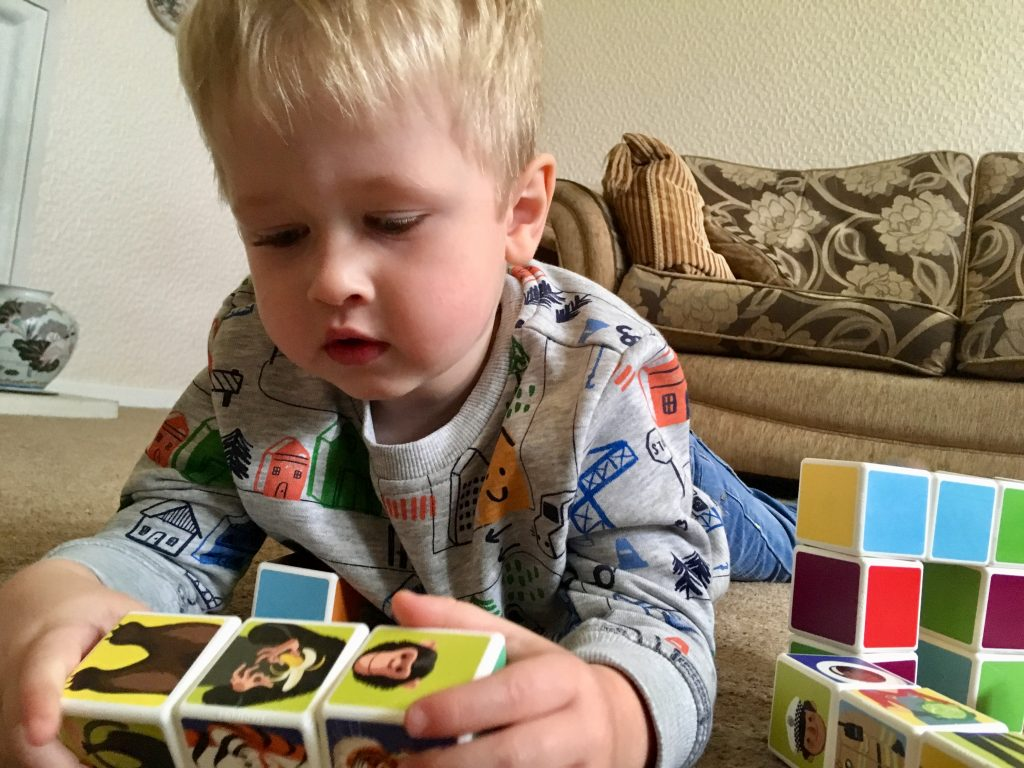 Geomag Magicube review. A close up if Lucas playing with the cubes with animals on