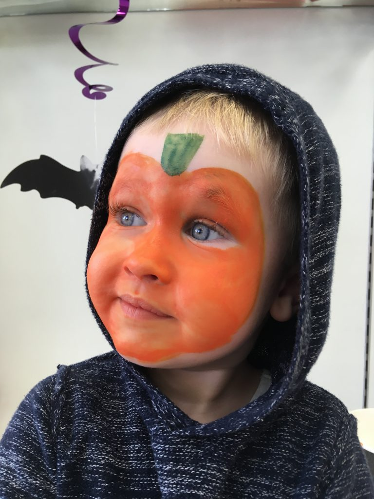 Affinity Lancashire Lucas has face painted as pumpkin
