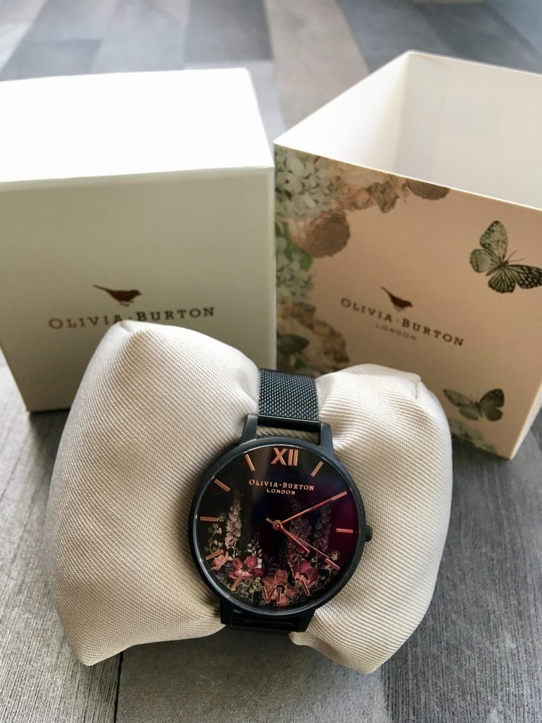 Bradbury's the Jewellers review black and floral Olivia burton watch on the cushion with the branded box behind