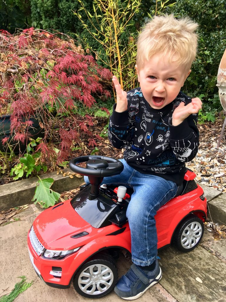 Ride on Range Rover and Mercedes review. Lucas is sat of the Range Rover smiling