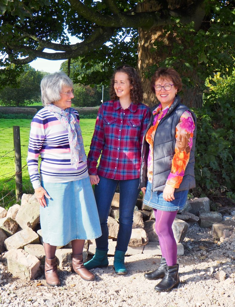 Hotter whisper boots my mum, grandma and i standing by some trres, my mum is smiling at the camera, I am looking at my grandma talking to her