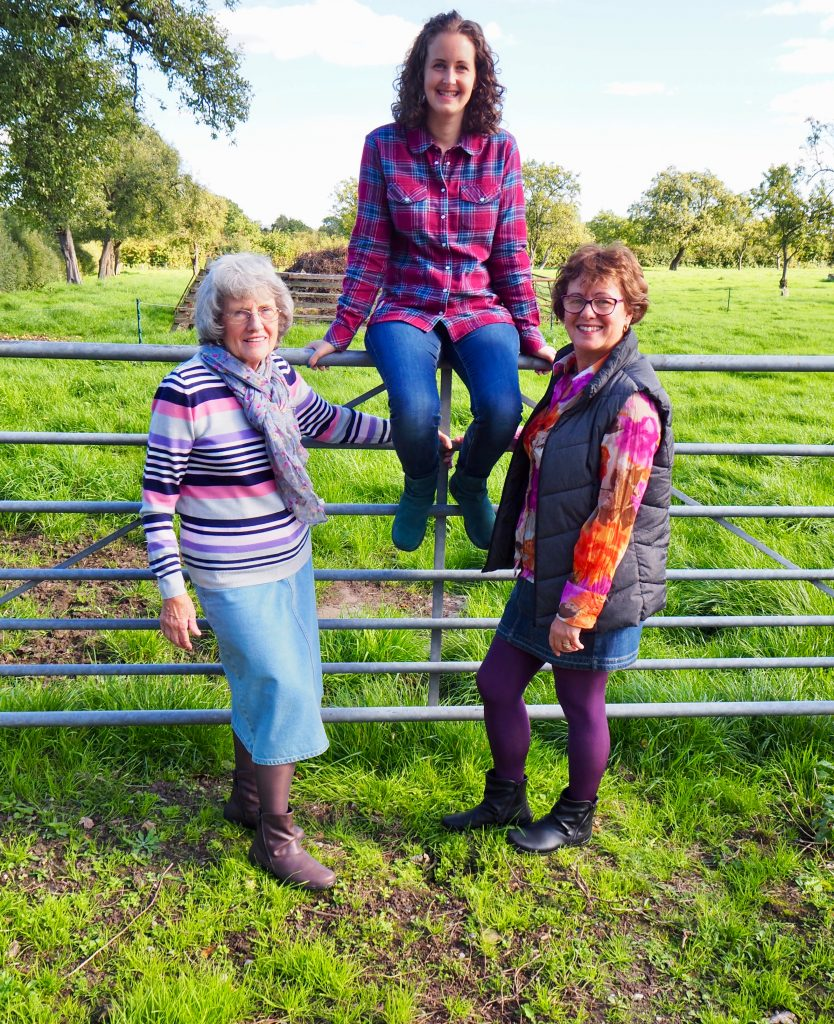 Hotter whisper boots, my mum and grandma are standing in front of a metal gate in a field with me sat in the middle on the gate