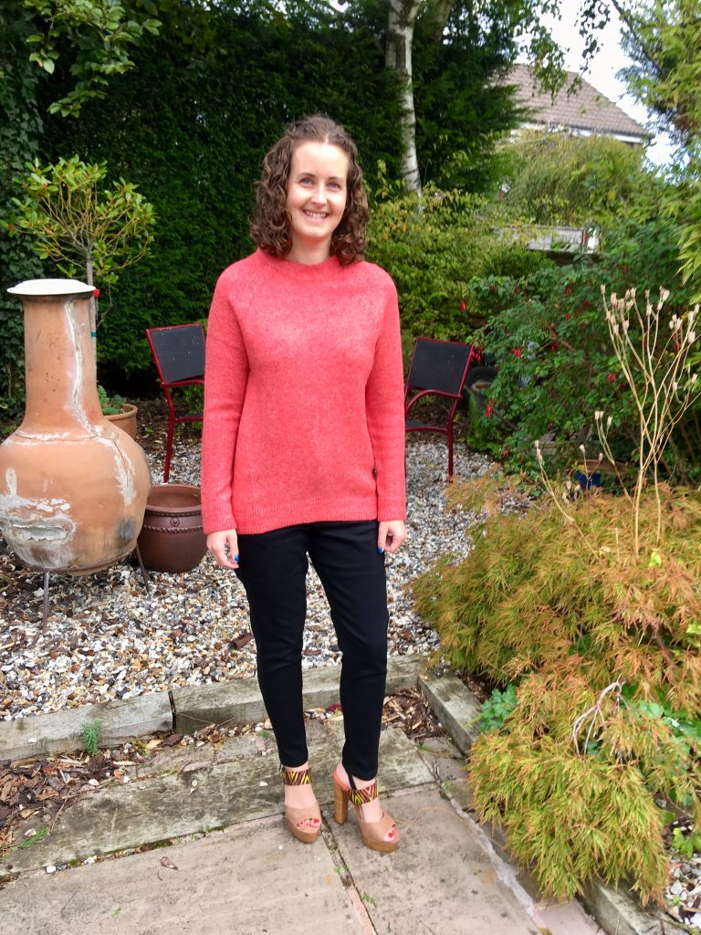Stepping out in Simply Be sandals in the Indian Summer. a photo showing me stood in the orange coral jumper, blaxck jean and sandals