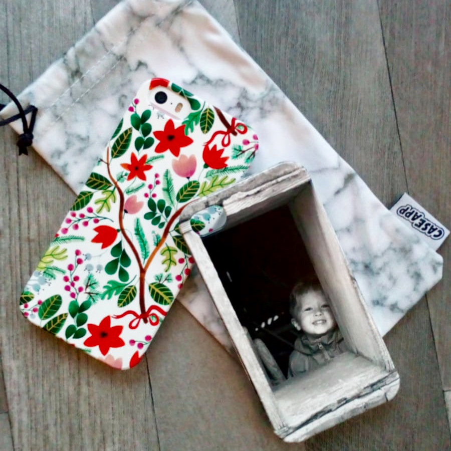 Men's gift ideas a floral phone case with a phone case with a picture of Lucas by the side of it