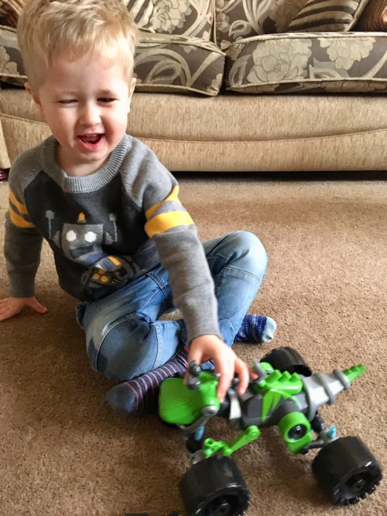 Rusty Rivets Botasaur review Lucas laughing whilst holding Botasaur