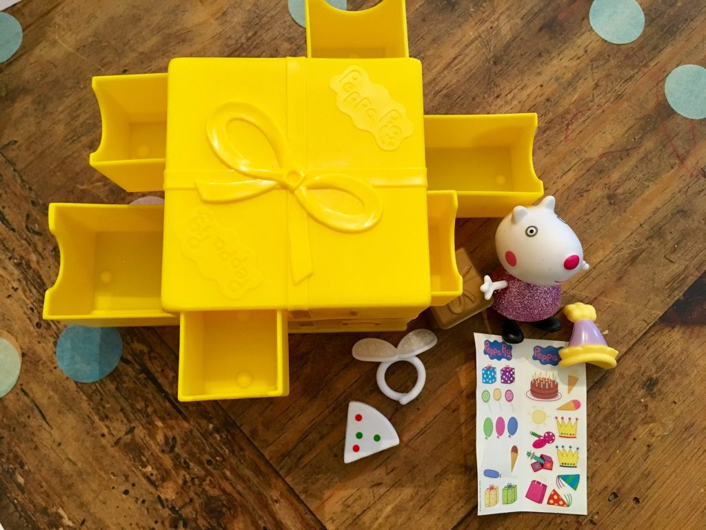 Peppa Secret Surprise review One of the yellow boxes with all drawers open and contents of drawer next to it