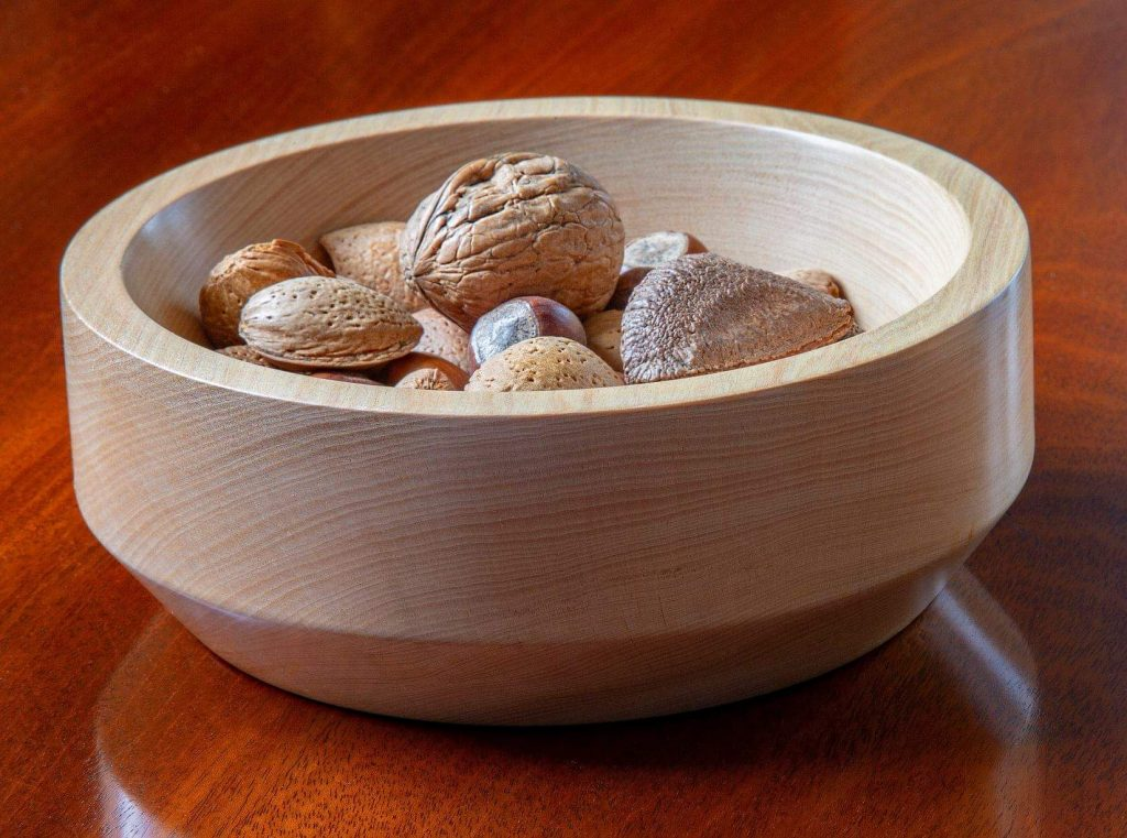 Food and drink gift ideas a wooden bowl with nuts in