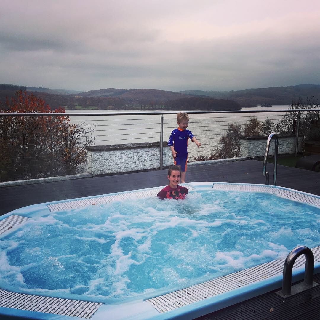 Beech Hill Hotel and Spa, Windermere review I'm in the outside jacuzzi and Lucas is stood behind me, behind us is lake windermere