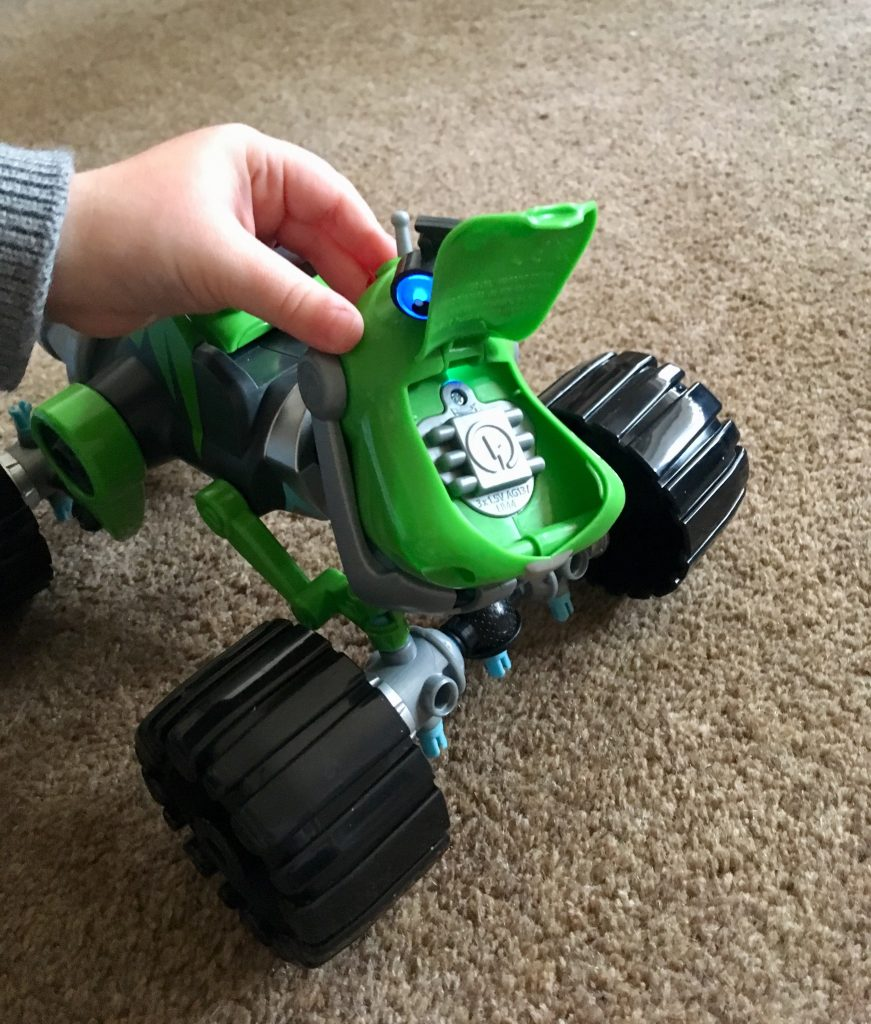 Rusty Rivets Botasaur review Lucas holding the Botasaur mouth open to show the grey compartment for batteries