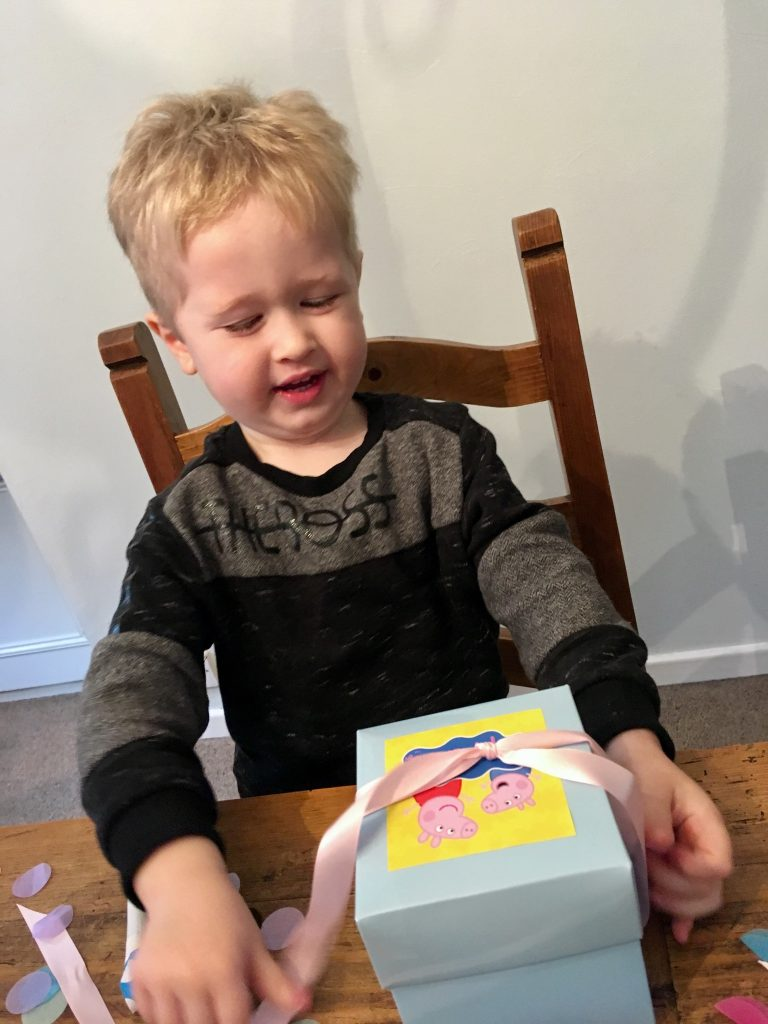 Peppa Secret Surprise review Lucas opening a Peppa branded box