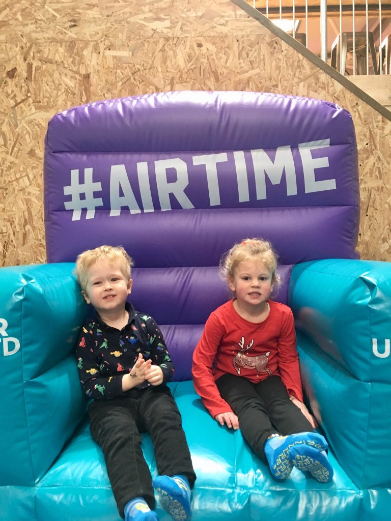 Air Unlimited Burnley review Lucas and S day on an inflatable chair looking at the camera