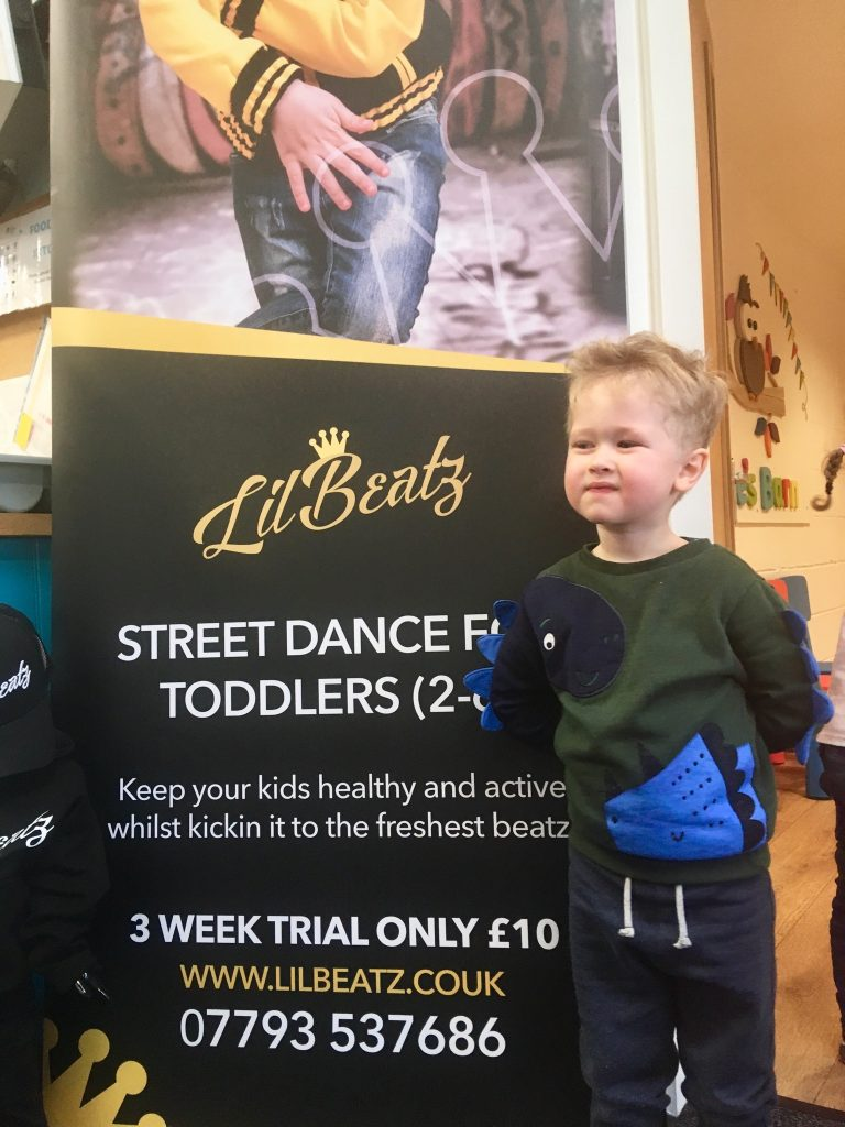Lil Beatz dance class review Lucas stood next to a banner saying 3 class trial for £10