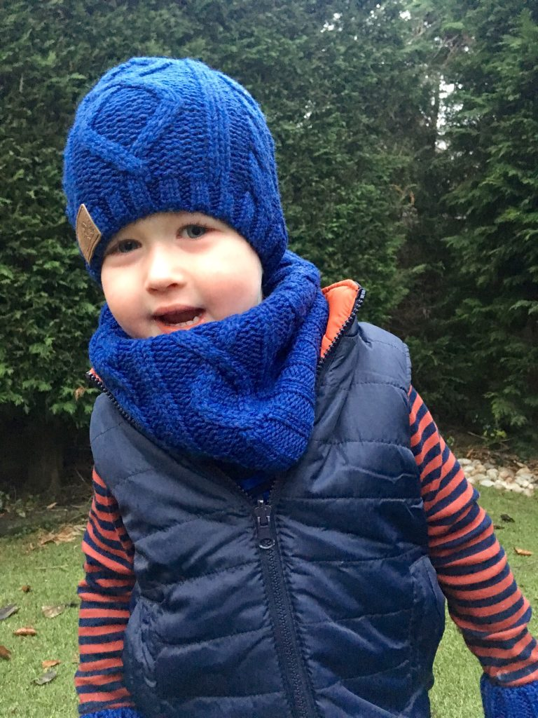 Vertbaudet Lucas wearing blue hat and snood over navy gilet