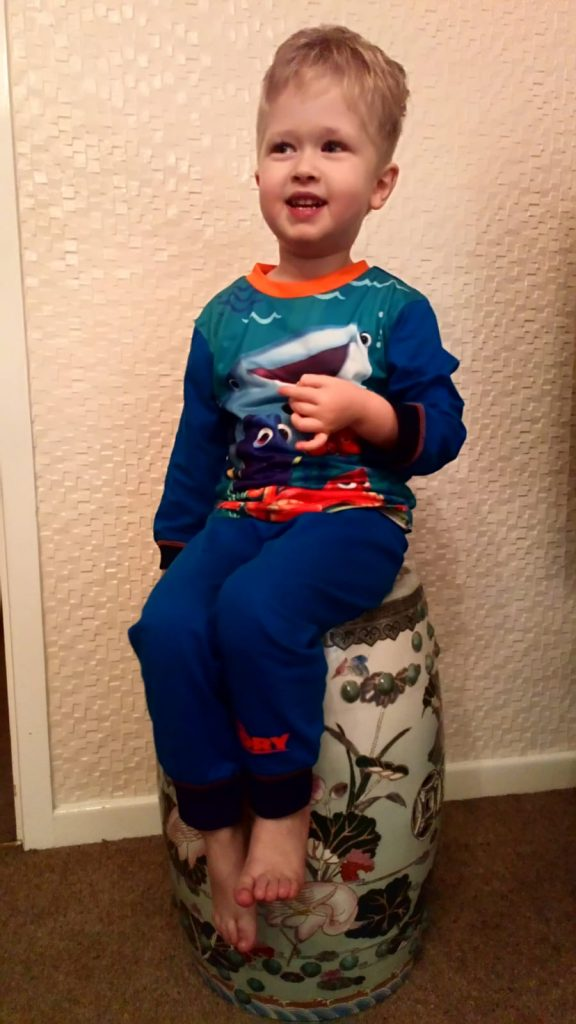 winter party ideas for children Lucas sat on a stool in his pjs