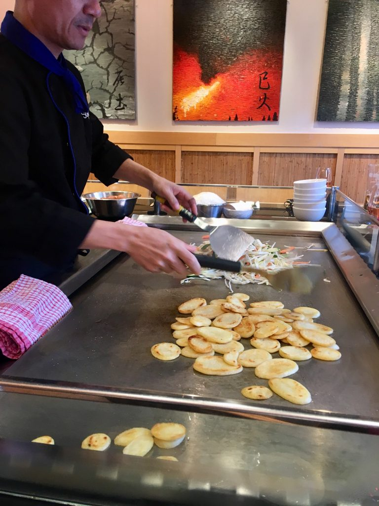 Sapporo Teppanyaki Manchester review. The chef is cooking veg on the hot plate