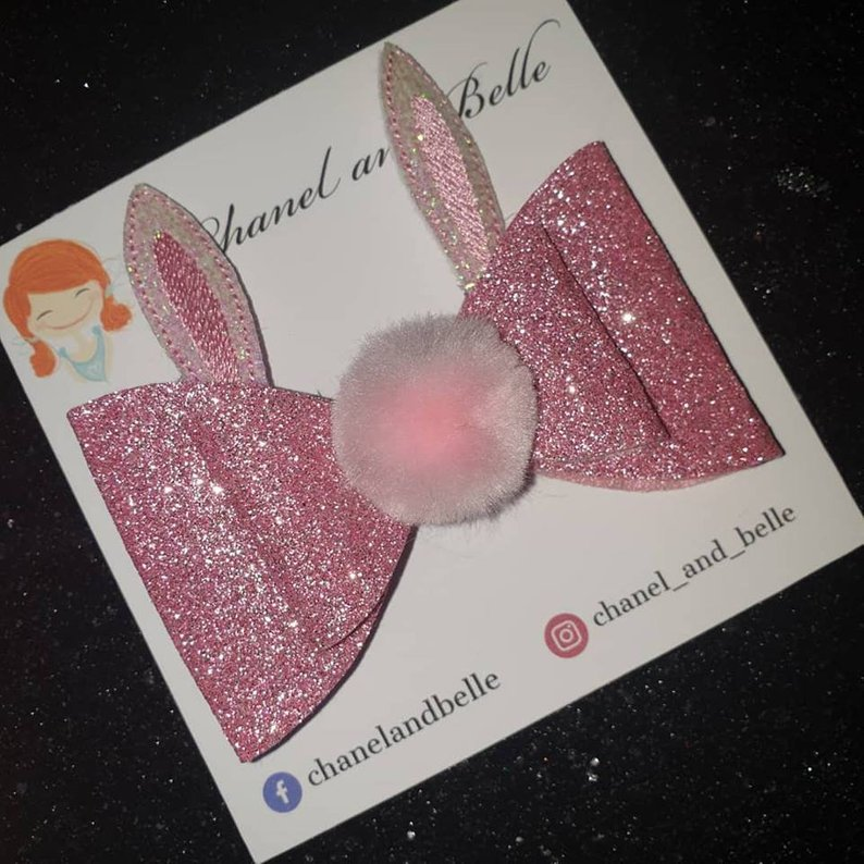 Easter gift ideas a pink g;littery boy with bunny ears