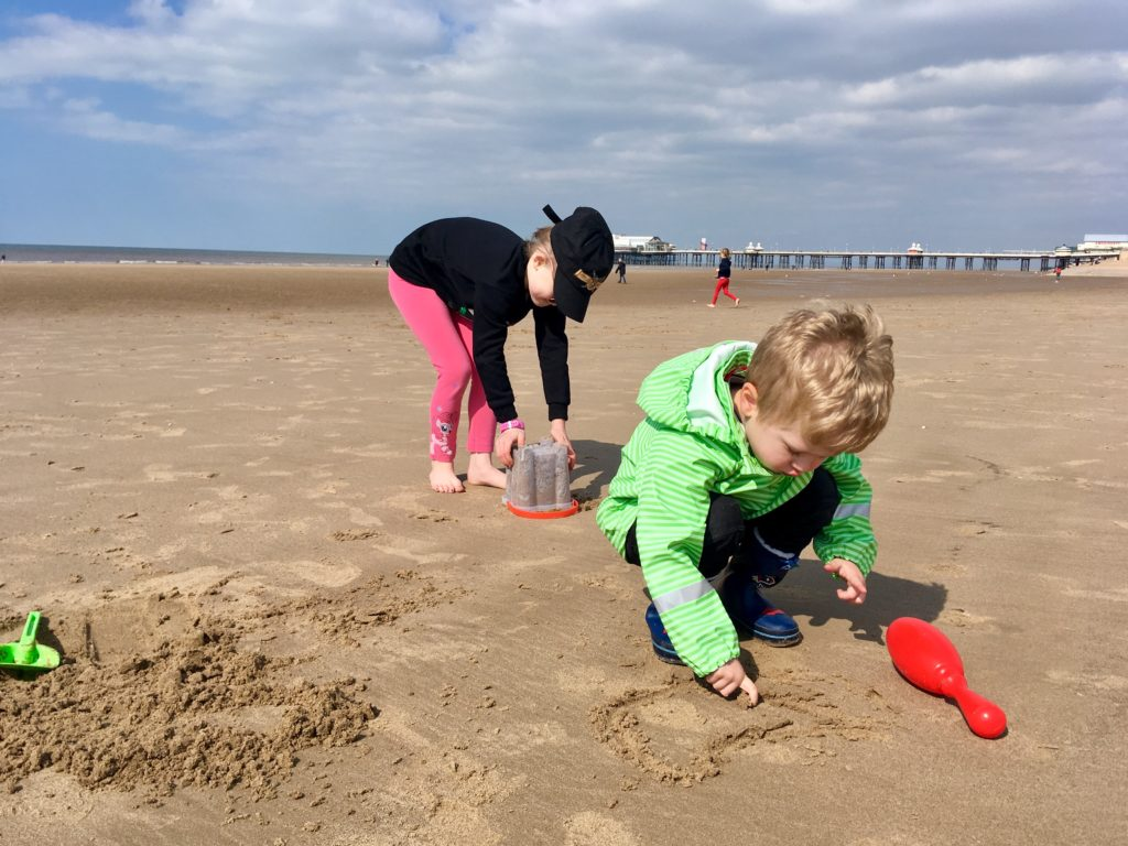 A day at Coral Island, Blackpool, Lucas and Chanel playing on the beach