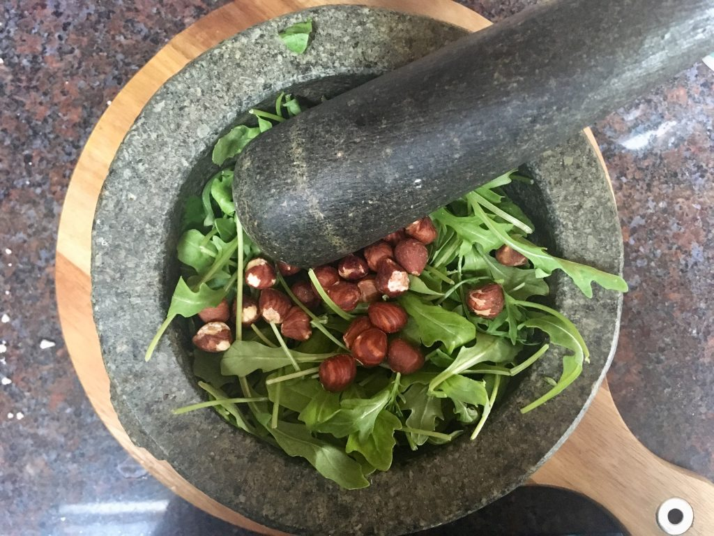 Veggie Packed Italian Soup Recipe from Hello Fresh. Basil rocket and hazelnuts in a black pestle and mortar
