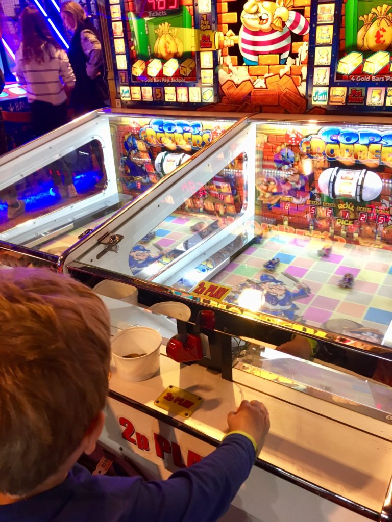 A day at Coral Island, Blackpool. Lucas sat at s 2p machine