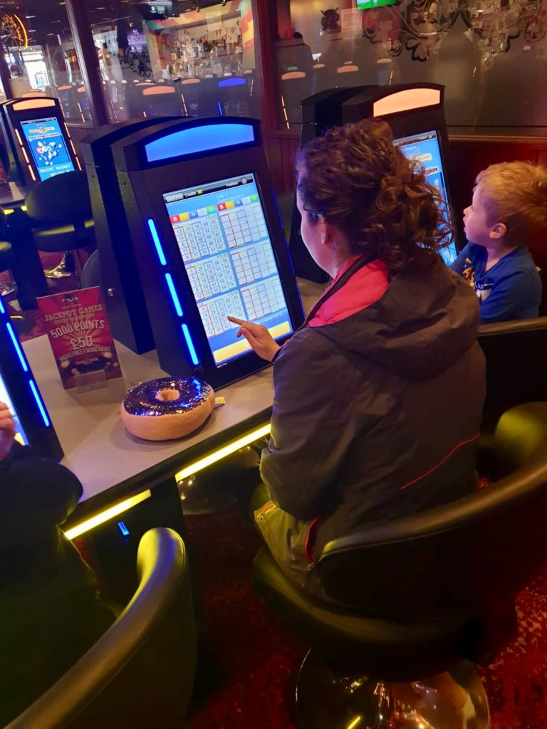 A day at Coral Island, Blackpool. Lucas and I sitting at the electronic bingoScreens