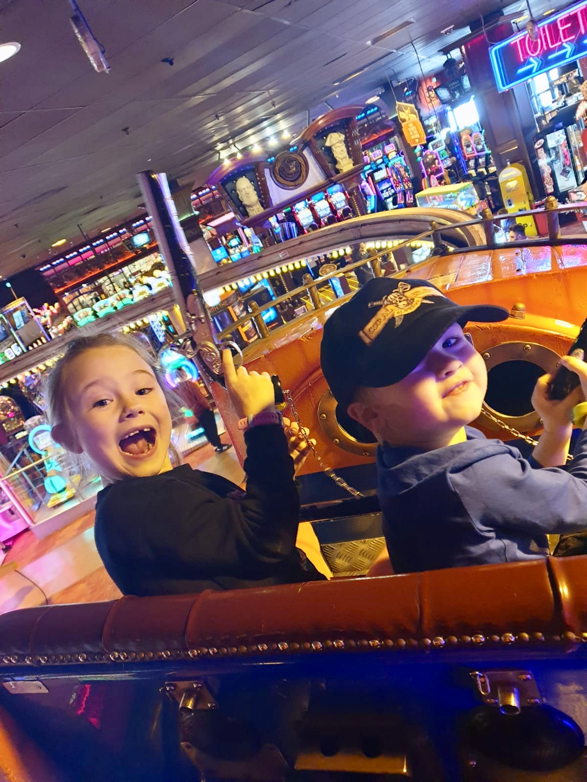 A day at Coral Island, Blackpool. Lucas and Chanel on the pirate flyer smiling at camera holding their pistols