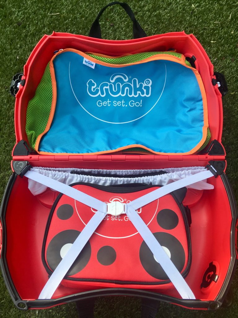 Travel with Trunki the Trunki is opened up showing the inside with the lunch bag and tidy bag in each side