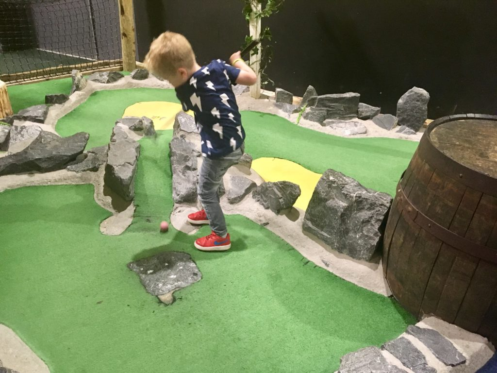 Lucas playing mini golf