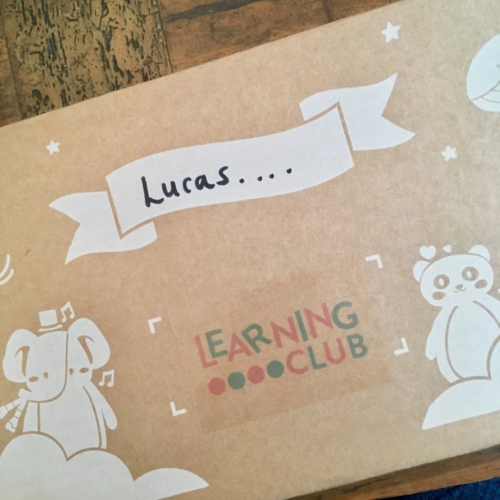 the cardboard learning club box with Lucas written on