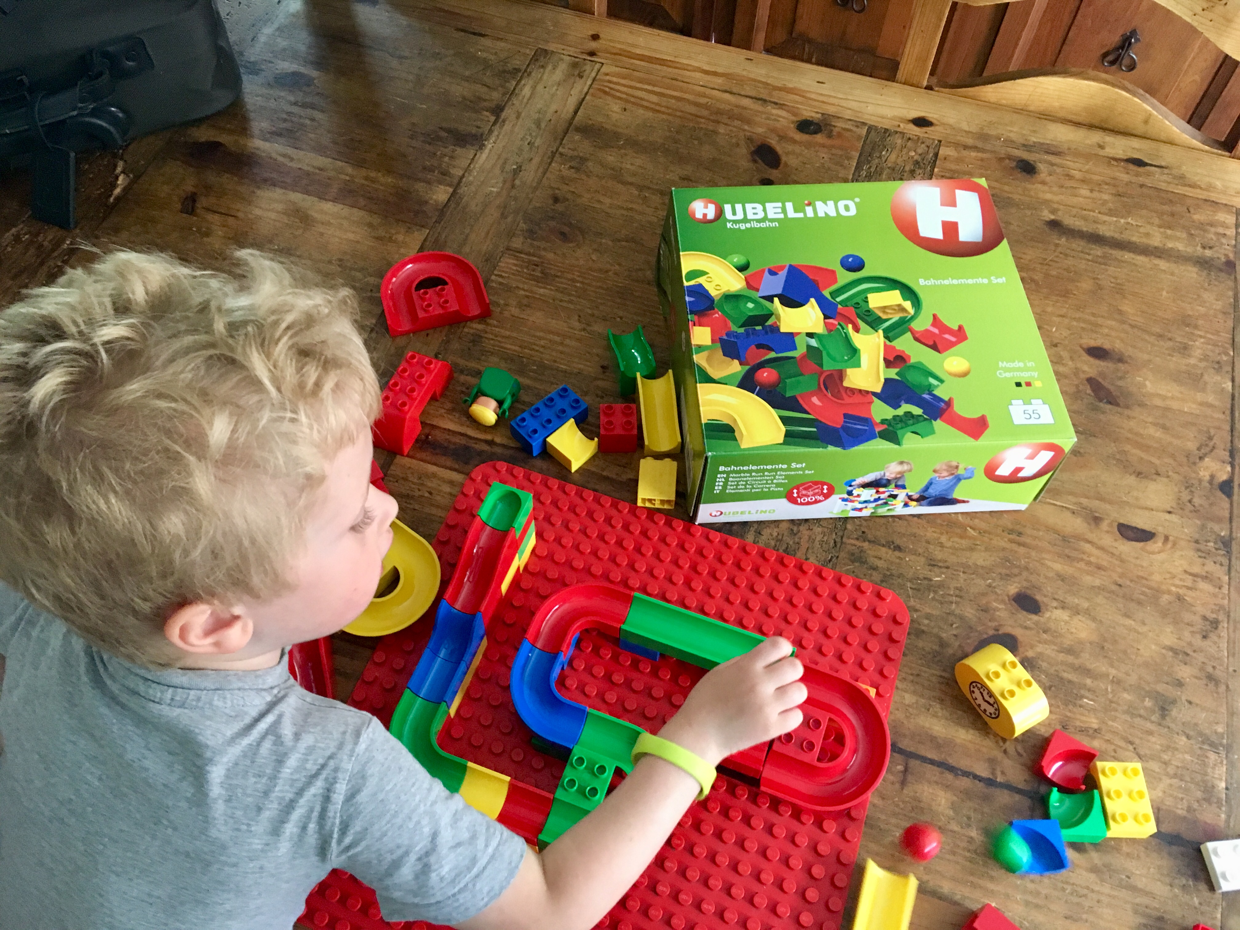 Lucas is playing with the marble run set and duplo