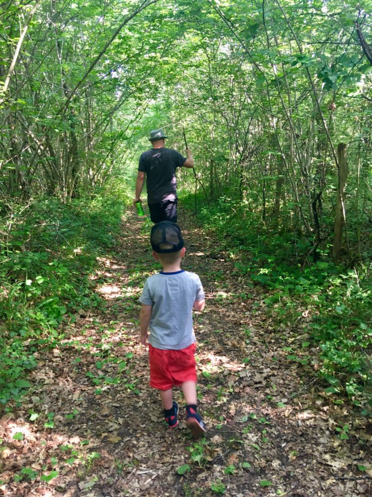 Lucas and D walking a woodland path