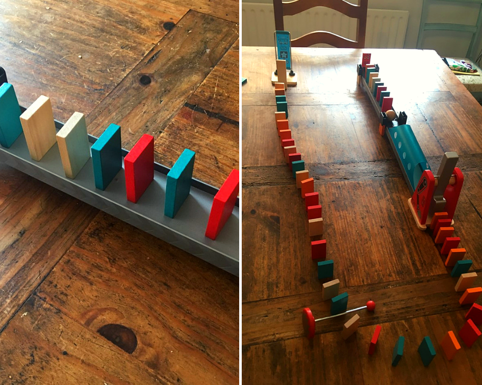 the dominoes set up on a wooden table