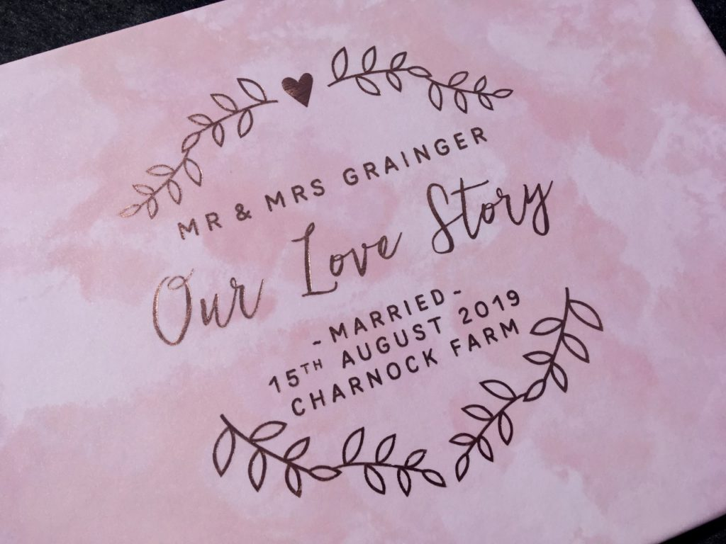 close up of pink book with rose gold writting