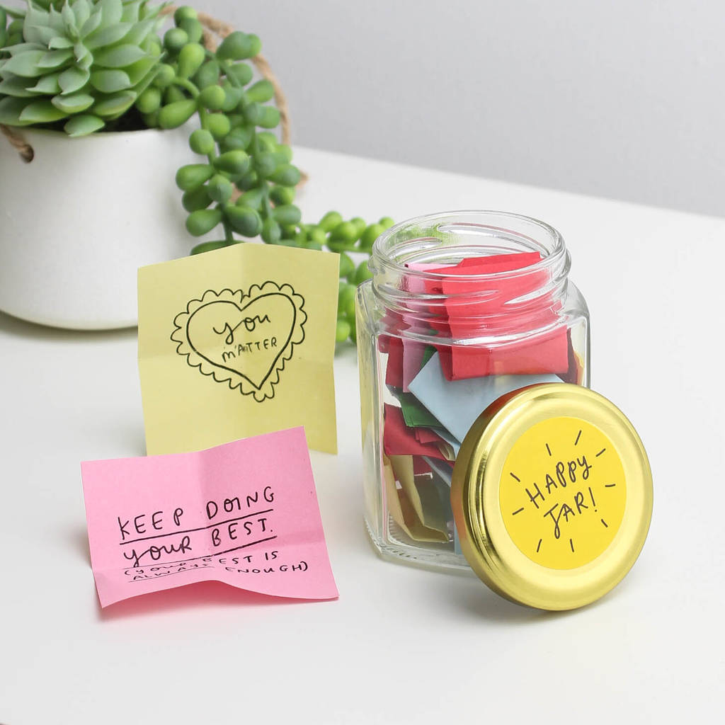 Happy notes in a glass jar