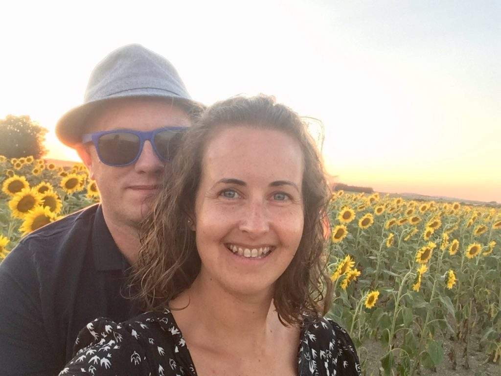 D and I looking at the camera, a field of sunflowers behind us