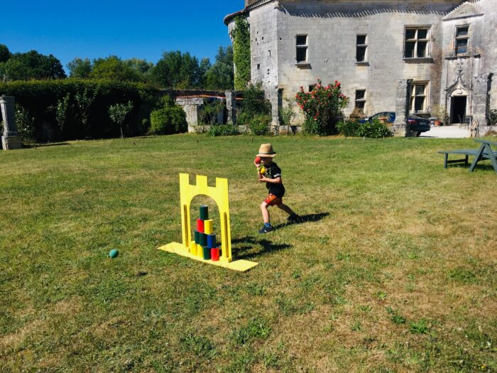 Lucas playing games on the lawn outside Mareuil chateau
