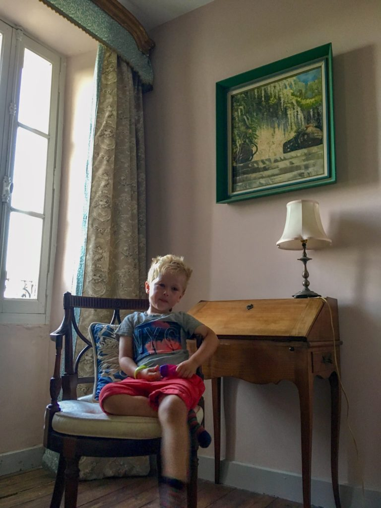 Lucas sat on a chair next to a writing desk