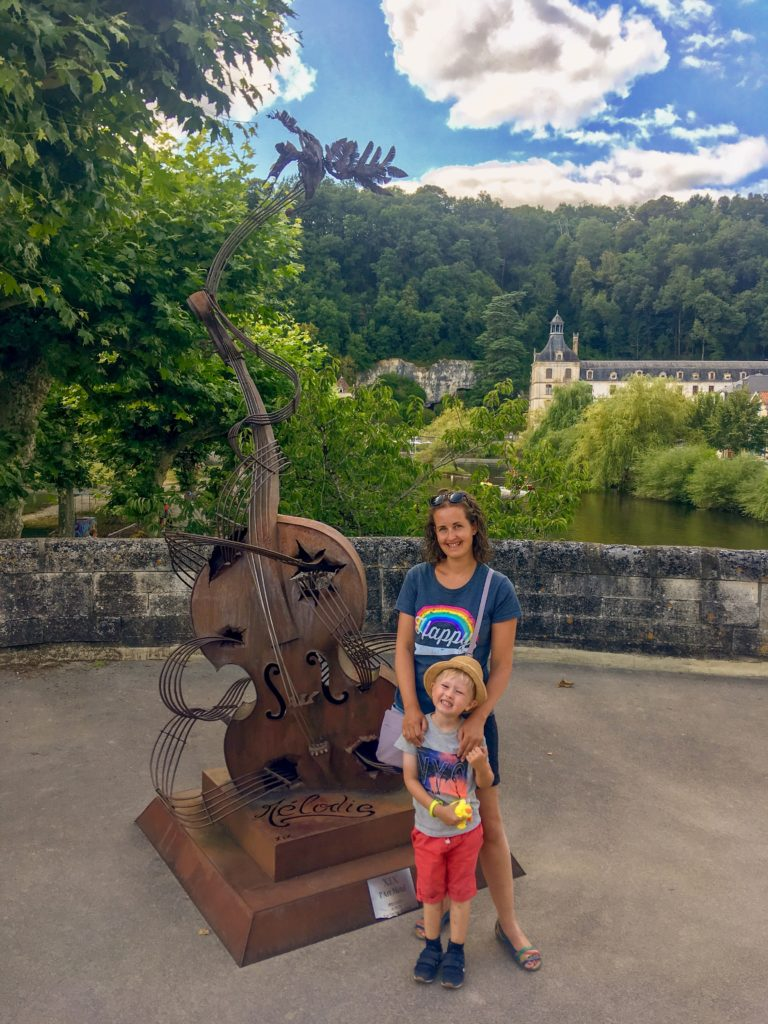 Lucas and I stood next to a violin sculpture in Brantome