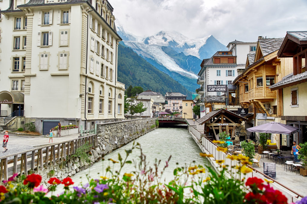 Skiing in France. Street view of Chamonix town, France. Chamonix, France - JULY 19, 2017: View of Chamonix town and Mont Blanc Massif, French Alps