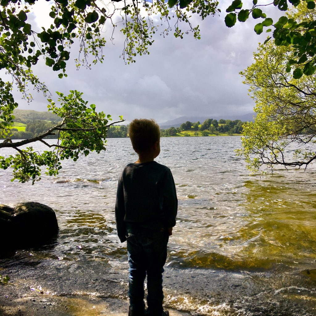 Lucas standing looking out over Windermere
