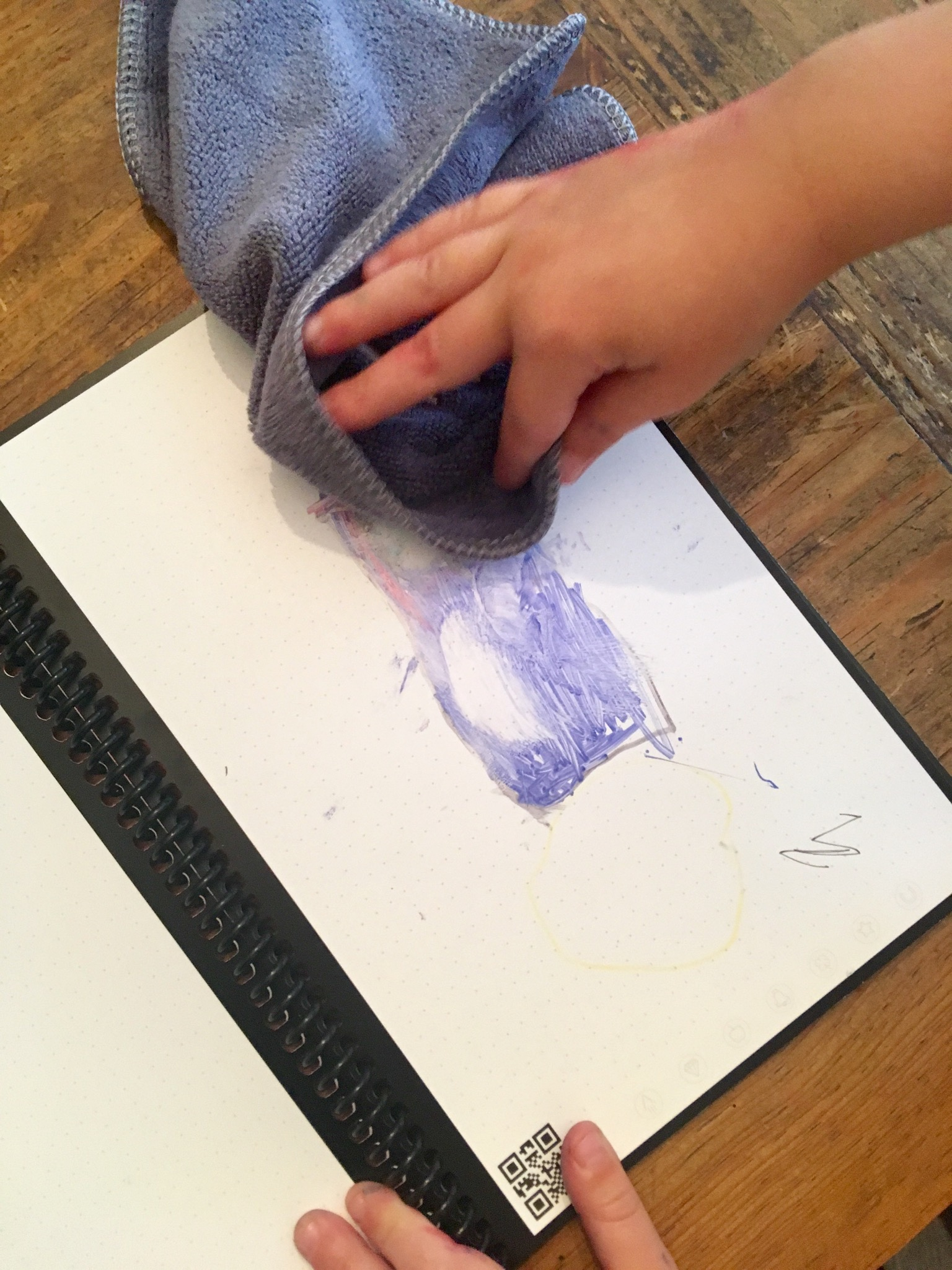 Lucas rubbing the drawing off the rocketbook everlast