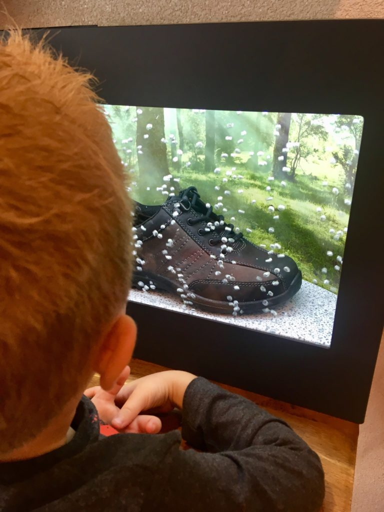 Lucas looking at a tank with waterproof shoes in at the Hotter Fit Fortnight