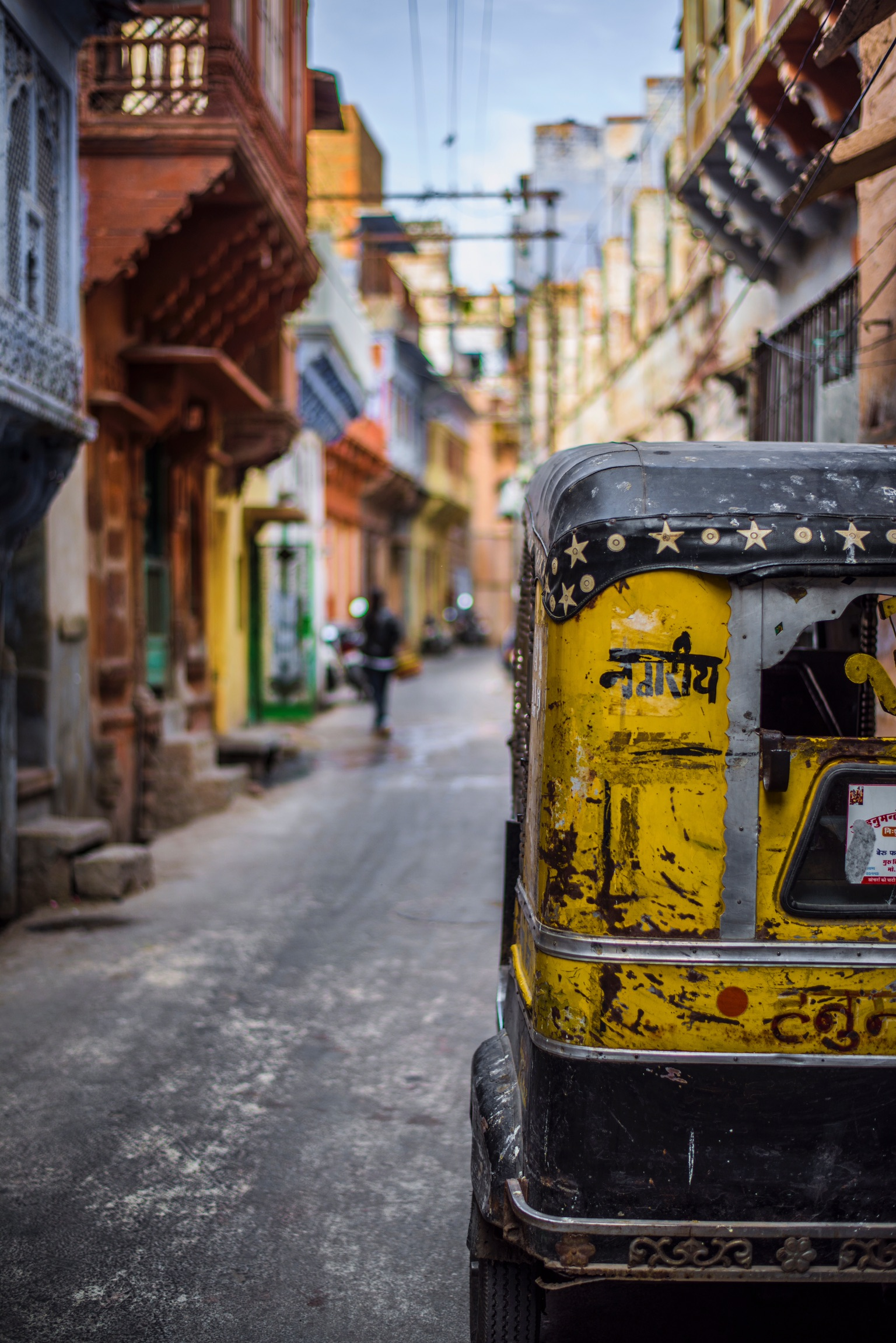 Visiting India with children photo of rickshaw on the street