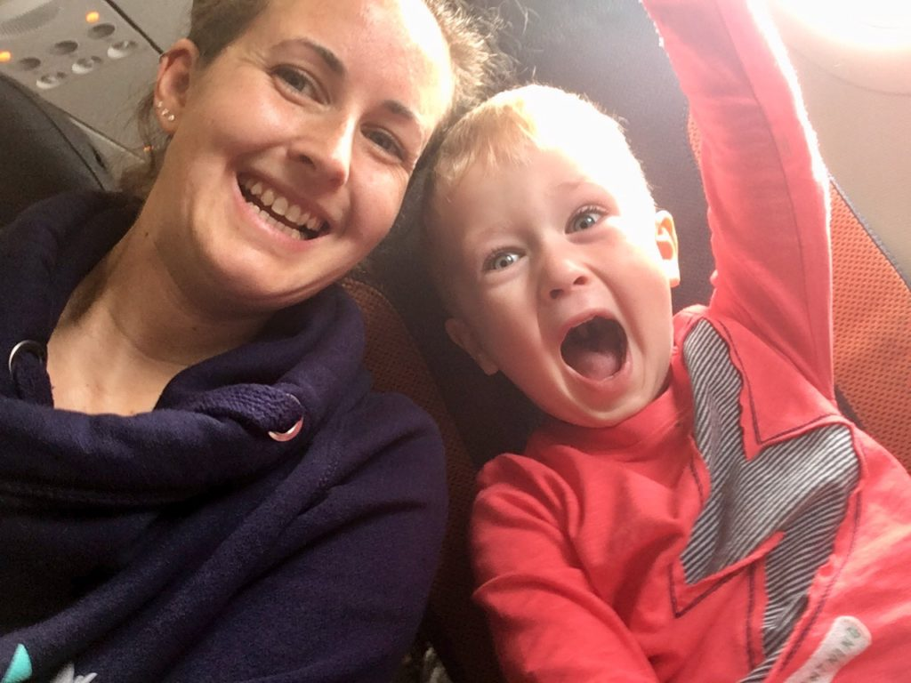 Lucas and I on the airplane smacking at the camera