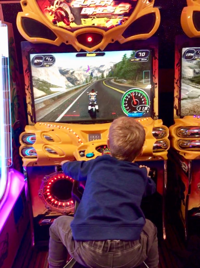 Lucas on a racing bike arcade game