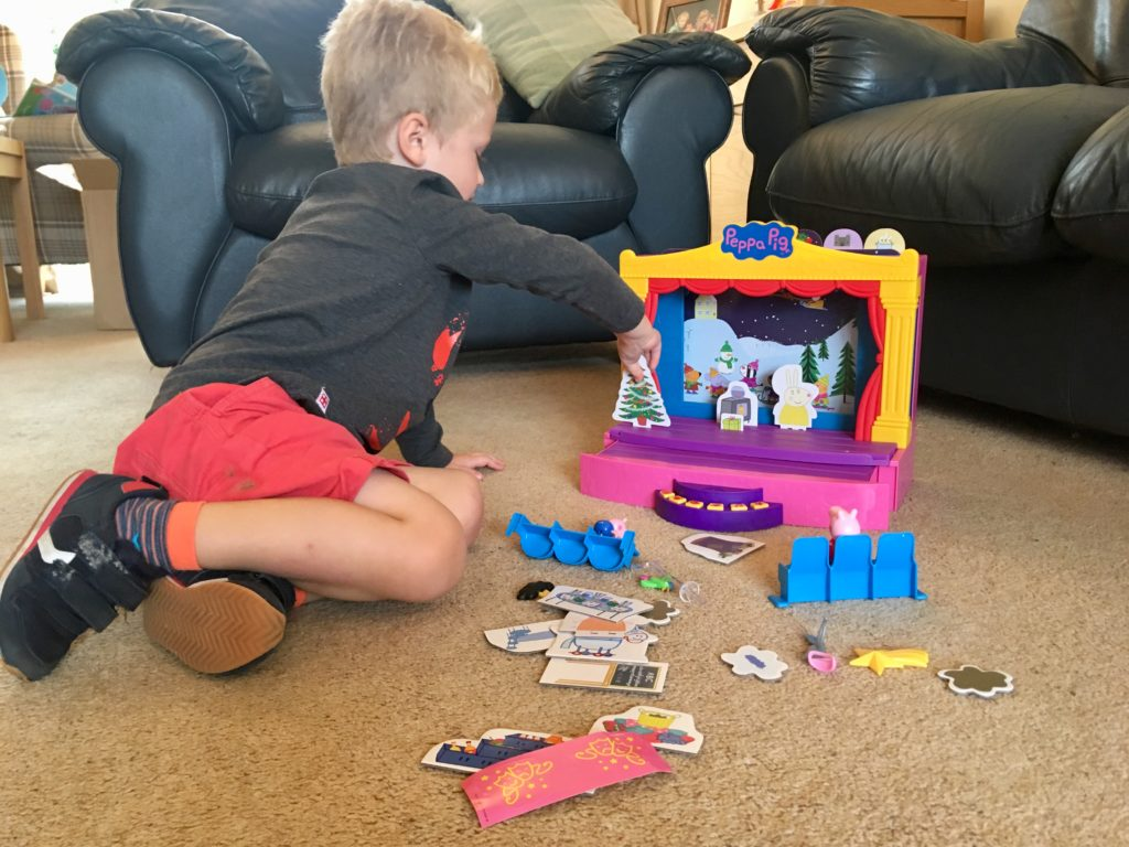 Lucas playing with the Peppa Pig stage playset
