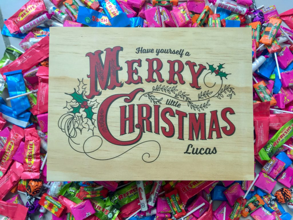 Personalised Christmas Eve box surrounded by swizzles sweets