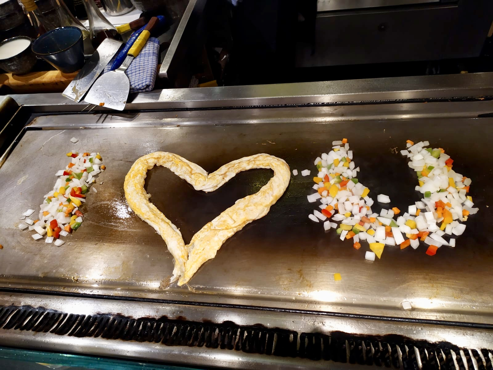 I heart u made out of food on a hot plate
