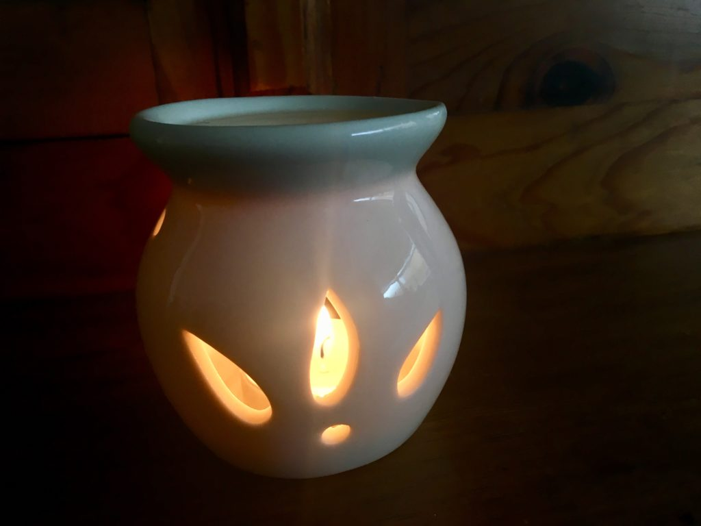 Wax burner lit showing flame