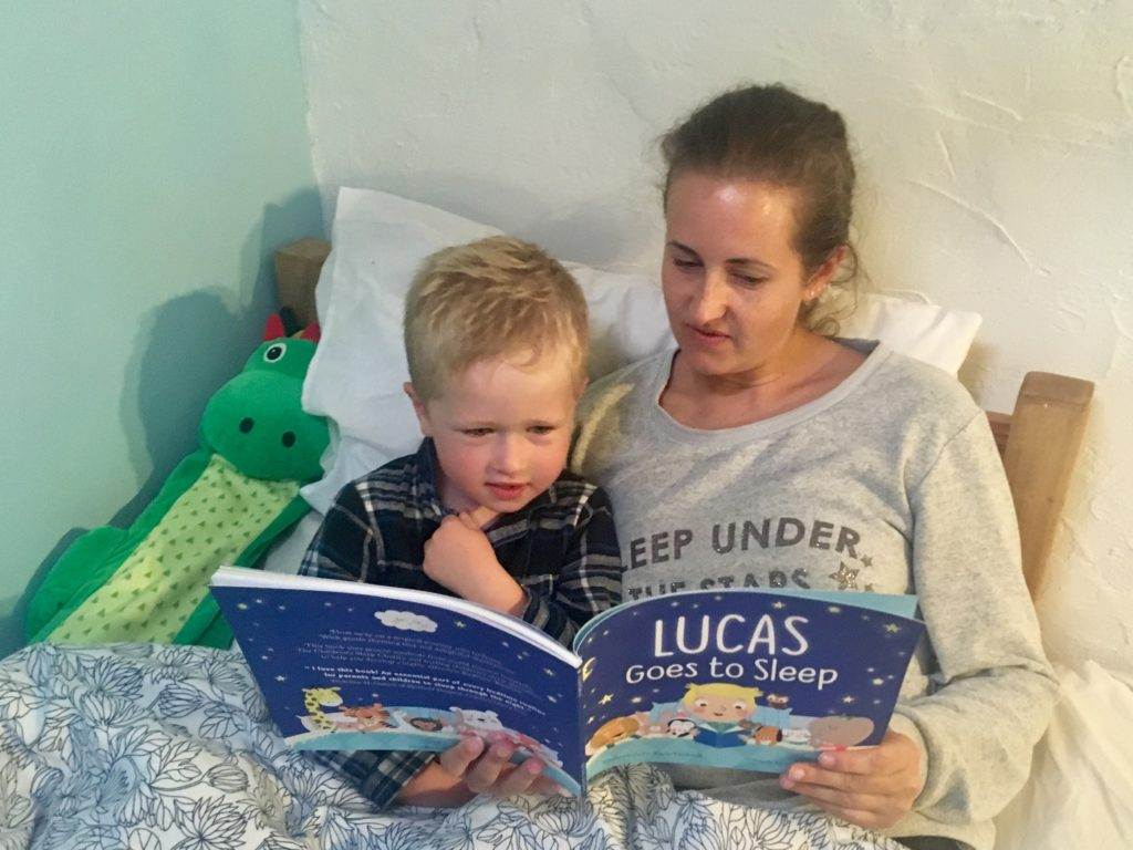 Me and Lucas in bed reading the book