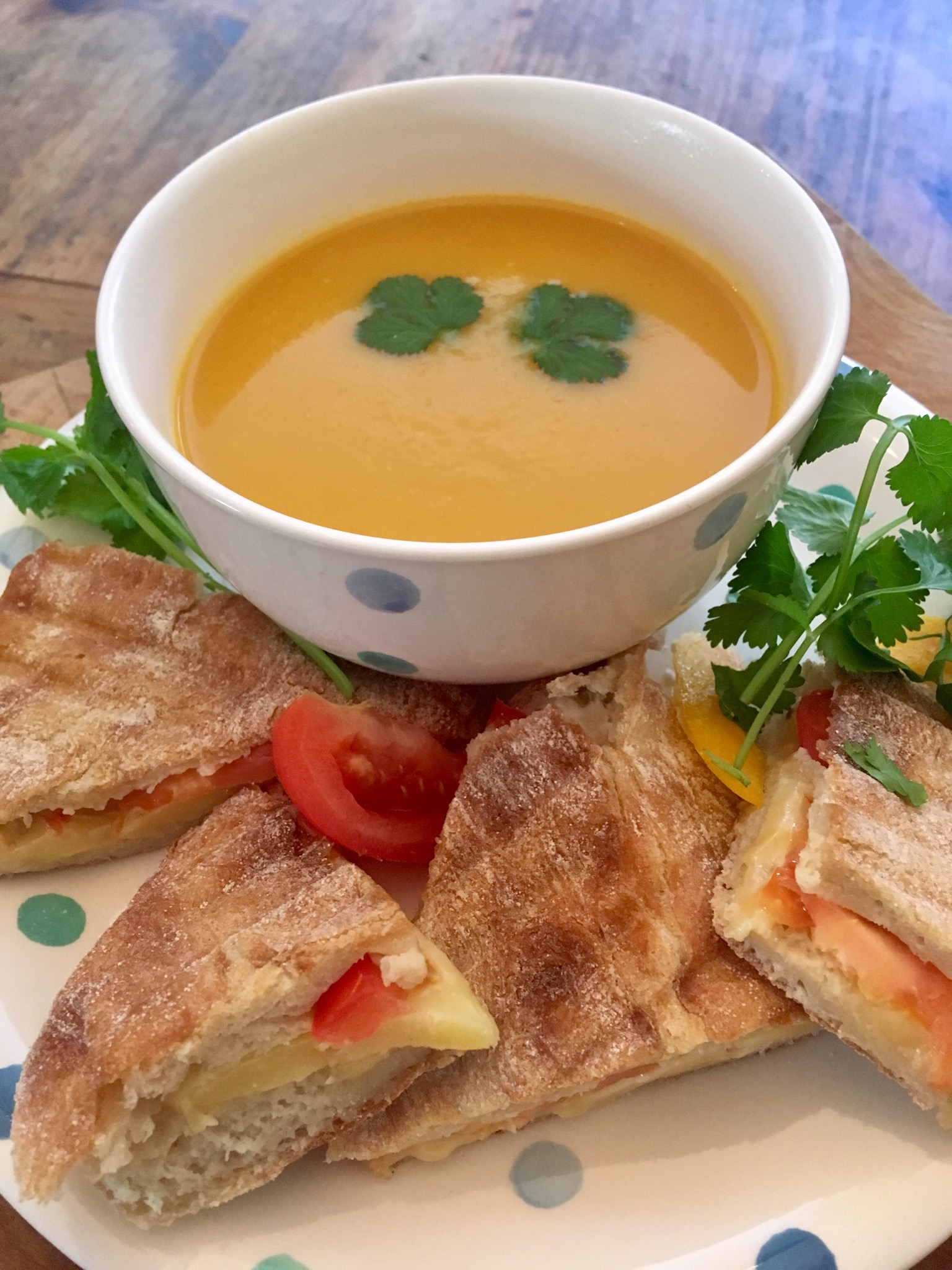 Carrot and coriander soup with cheese and tomato ciabatta